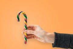 Donante de un bastón de caramelo Imágenes de archivo libres de regalías