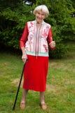 Donante mayor elegante de la mujer pulgares para arriba Fotografía de archivo