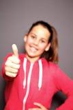 Donante sonriente feliz del niño pulgares para arriba Imagenes de archivo