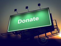 Donate - Billboard on the Sunrise Background. Stock Photo