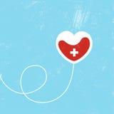 Donate blood bag on blue background. Stock Image