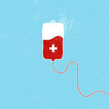 Donate blood bag on blue background. Royalty Free Stock Photography