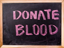 Donate blood  word on blackboard Stock Photography