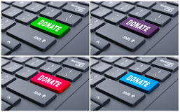 Donate button on computer keyboard Stock Photos