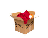 Donate Clothes Isolated On White. Cardboard box full of used clothing ready to donate to a charity.  Isolated on white background Stock Photos