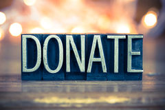 Donate Concept Metal Letterpress Type Royalty Free Stock Images