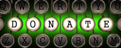 Donate Concept on Old Typewriter's Keys. Royalty Free Stock Photo