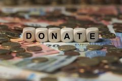 Donate - cube with letters, money sector terms - sign with wooden cubes. Series of cube with letters from money sector Stock Photo