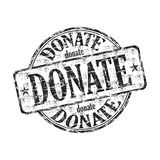 Donate grunge rubber stamp Royalty Free Stock Photography