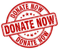 Donate now red grunge round stamp Royalty Free Stock Image