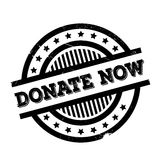 Donate Now rubber stamp Stock Photography