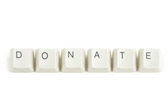 Donate from scattered keyboard keys on white Stock Photo