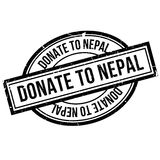 Donate To Nepal rubber stamp Royalty Free Stock Images