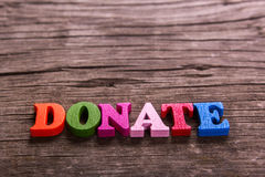 Donate word made of wooden letters Royalty Free Stock Photos