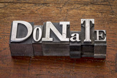 Donate word in metal type Royalty Free Stock Photos