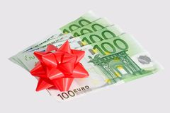 Donated. Five onehundred Euro notes with red bow - isolated Royalty Free Stock Image