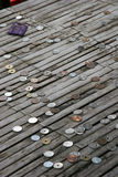 Donated Coins. Japanese coins on a bamboo table. Donated from visitors at a temple in Kyoto, Japan Royalty Free Stock Images