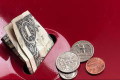 Donated money sits in salvation army collection Stock Photos
