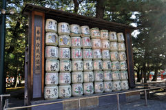 Donated sake on display. Casks and casks of Japanese rice wine (sake) stacked on each other outside Heian jingu (Heian shrine) in Kyoto, Japan as preparations royalty free stock photo
