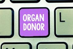 Donateur d'organe des textes d'écriture de Word Concept d'affaires pour A démontrant pour qui offre un organe de leur corps photographie stock libre de droits