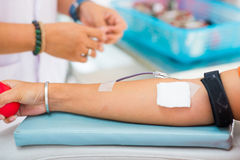 Donating blood in a hospital room Royalty Free Stock Images