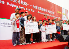Donating for cancer reseach. 2007 The 9th Beijing Terry Fox Run --Donating for cancer research.children from International School in Beijing donating Royalty Free Stock Photo