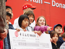 Donating for cancer reseach. 2007 The 9th Beijing Terry Fox Run --Donating for cancer research.children from International School in Beijing donating Stock Photos