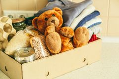 Donating concept - food, clothes, toys in cardboard royalty free stock photography