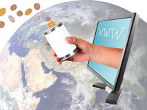 Donating different currencies through internet. Conceptual image of donating money to the world in different currencies through the internet Stock Photo