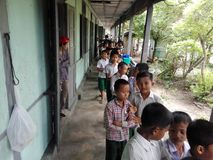 Donation à l'école Photo libre de droits