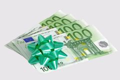Donation. Five onehundred euro notes with green bow - isolated stock photo
