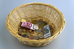 Donation basket for collection. Royalty Free Stock Images