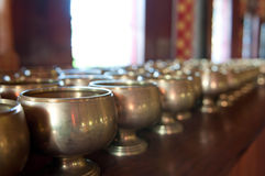 Donation bowls in temple Stock Image