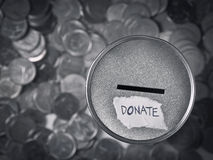 Donation box. With coins in monotone Stock Images