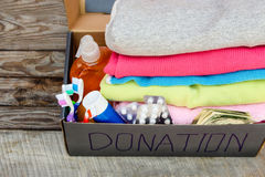 Donation box with clothes Stock Photos