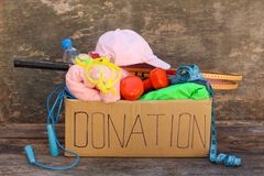 Donation box with sporting goods Stock Photography