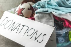 Donation box with toys, clothes and food stock image