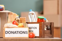 Donation boxes with food products. On table indoors royalty free stock photo