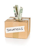 Donation cardboard box with dollar banknotes and coins Royalty Free Stock Photos