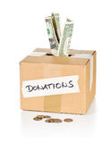 Donation cardboard box with dollar banknotes and coins Stock Photos