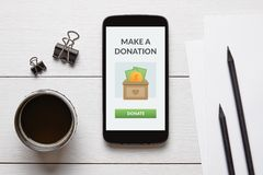 Donation concept on smart phone screen