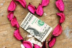 Donation d'argent dans la conception de coeur Photos libres de droits