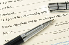 Donation form. Blue pen pointing donation word royalty free stock photo