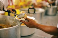 Hands-on food of the hungry is the hope of poverty : concept of homelessness. The donation is a hope for hungry people to fight : Care concept royalty free stock photos