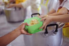 Hands-on food of the hungry is the hope of poverty : concept of homelessness. The donation is a hope for hungry people to fight : Care concept royalty free stock photography