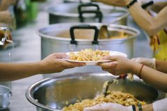 Hands-on food of the hungry is the hope of poverty : concept of homelessness. The donation is a hope for hungry people to fight : Care concept stock image