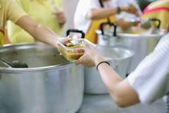 Hands of the poor receive food from the donor`s share. poverty concept. The donation is a hope for hungry people to fight : Care concept stock photography