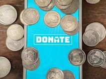 Donation money online by technology royalty free stock photos