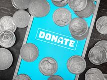 Donation money online by technology stock photography