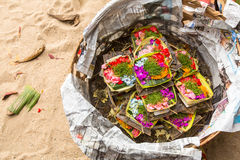 Donations sacrifice during Melasti Ritual. Ceremony is held on the edge of the beach with the aim to purify oneself of all the bad. SANUR, BALI - MAR 18, 2016 Royalty Free Stock Photos